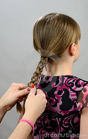 Making a hair braid for little girl