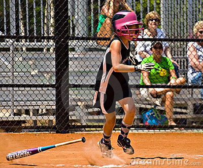 Making a Hit Girl s Softball Editorial Photo