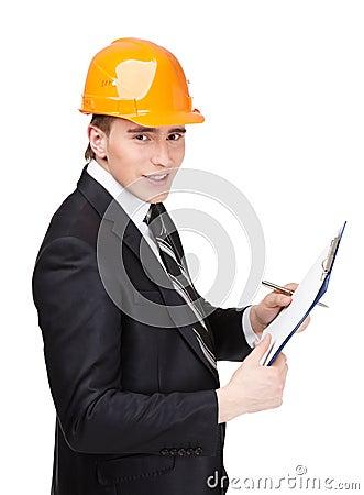 Making notes man in helmet