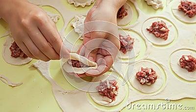 Making russian meat dumplings