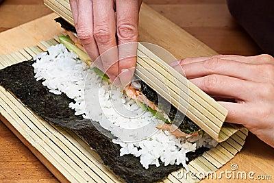 Making sushi rolls.