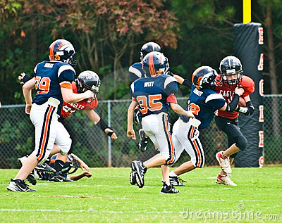 Making the Tackle/Little League Editorial Photo