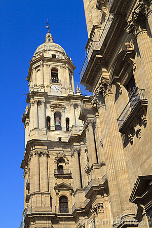 Malaga Cathedral against a deep blue sky