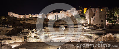 Malaga landmarks on night. Roman theater and Alcazaba. Andalusia, Spain