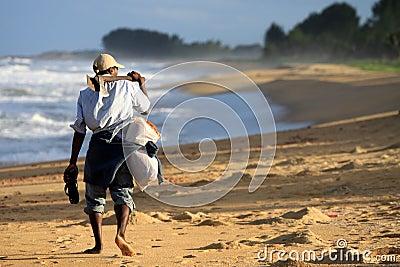 Malagasy man walking on a beach Editorial Image