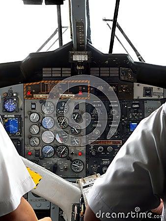 Malaysia. Pilots at Cockpit Controls