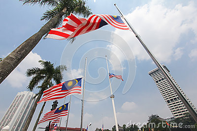 Malaysian flags at half mast following MH17 incident Editorial Stock Image