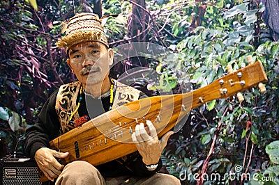 Malaysian sape player at BIT 2012   Editorial Photo