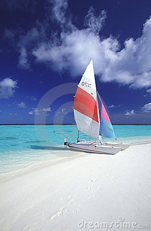 Maldives catamaran on tropical beach