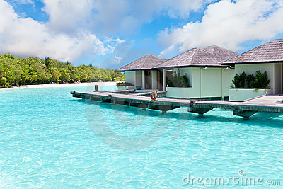 Maldives. Villa on piles on water against island