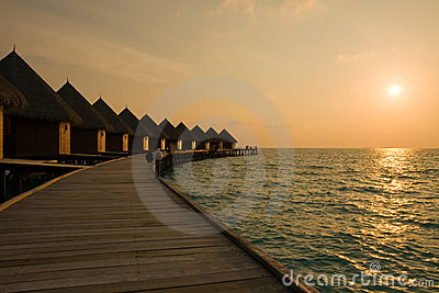 Maldives. Villa on piles on water at the time suns