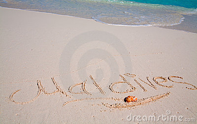 Maldives written on sand