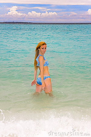 Maldives. Young pretty woman in ocean