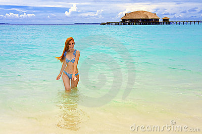 Maldives.Young pretty woman will leave from ocean