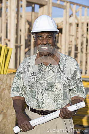 Male Architect With Blueprint At Construction Site