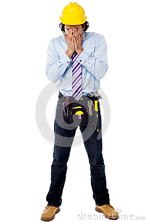Male architect in a hard hat with toolkit