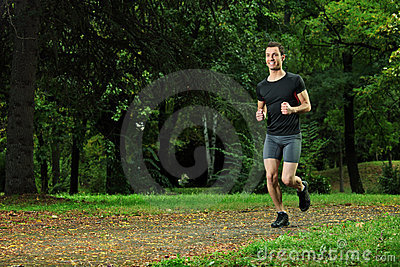 Male athlete jogging on a trail