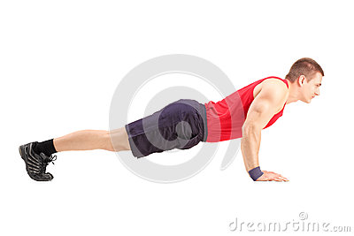 Male athlete in a sportswear doing push ups