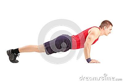Male athlete in a sportswear doing push ups