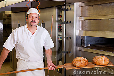 Male baker baking bread
