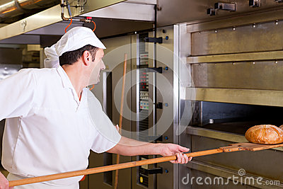 Male baker baking bread