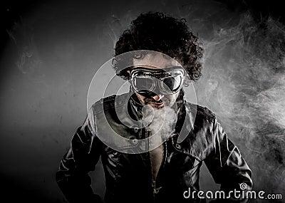 Male biker with sunglasses era dressed Leather jacket, huge smok