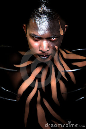 Male with body paint and claws