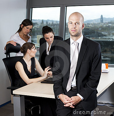 Male boss standing in front of his collegues
