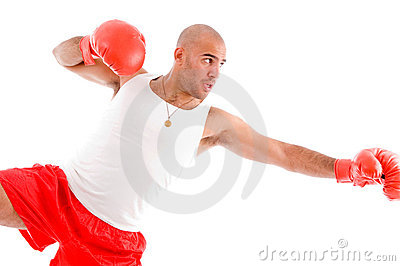 Male boxer in pose to punch hard