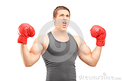 Male boxer with red boxing gloves gesturing happiness