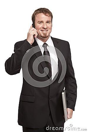 Male businessman talks on phone