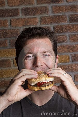 Male Carnivore sinks teeth into burger