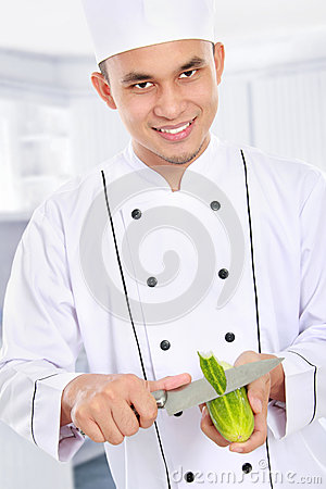 Male chef preparing some food