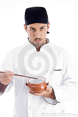 Male chef presenting chinese dish