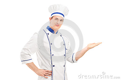 Male chef in a uniform gesturing with hand