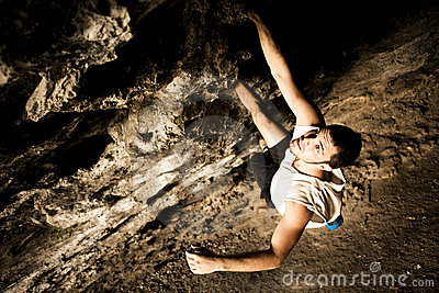 Male climber on cave