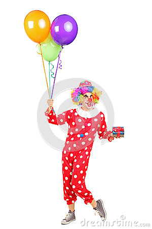 Male clown with a bunch of balloons