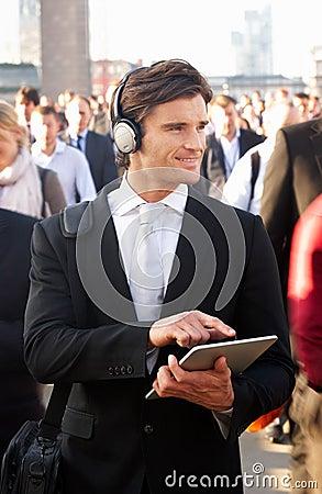 Male commuter in crowd