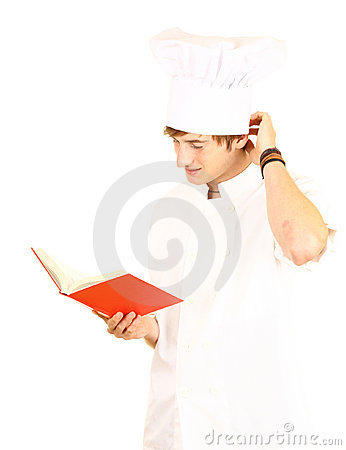 Male cook reading book