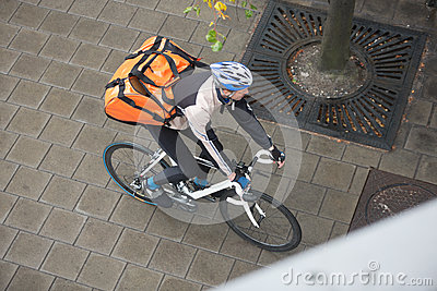 Male Cyclist With Backpack On Sidewalk
