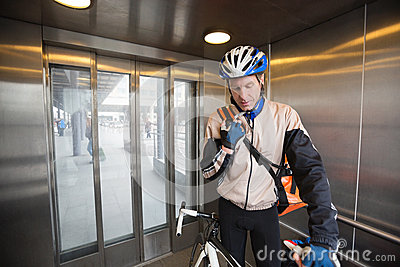 Male Cyclist With Courier Bag In An Elevator