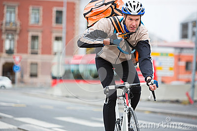 Male Cyclist With Courier Delivery Bag Riding