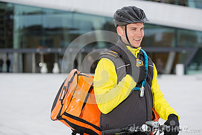 Male Cyclist With Courier Delivery Bag Using