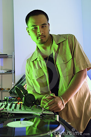 Free Male DJ Leaning On Turntable. Royalty Free Stock Photo - 2037195