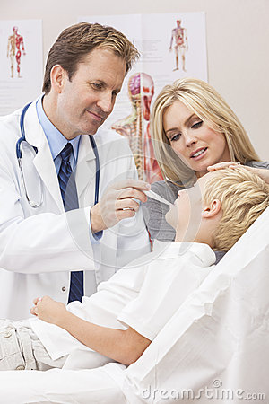 Male Doctor Examining Boy Child With Mother