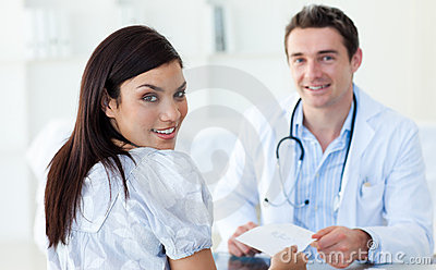 Male doctor giving a prescription to his patient
