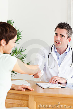 Male Doctor greeting a patient