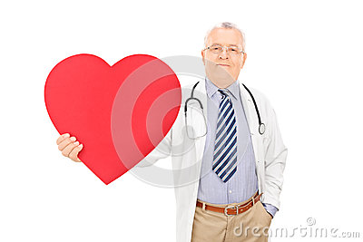 Male doctor holding a big red heart