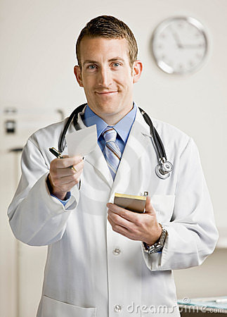 Male doctor holding out prescription sheet