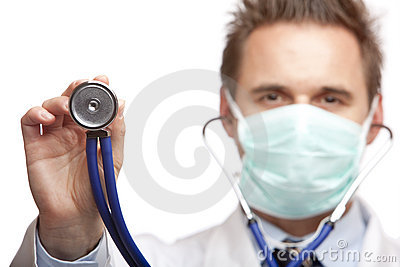 Male doctor holding stethoscope for examination